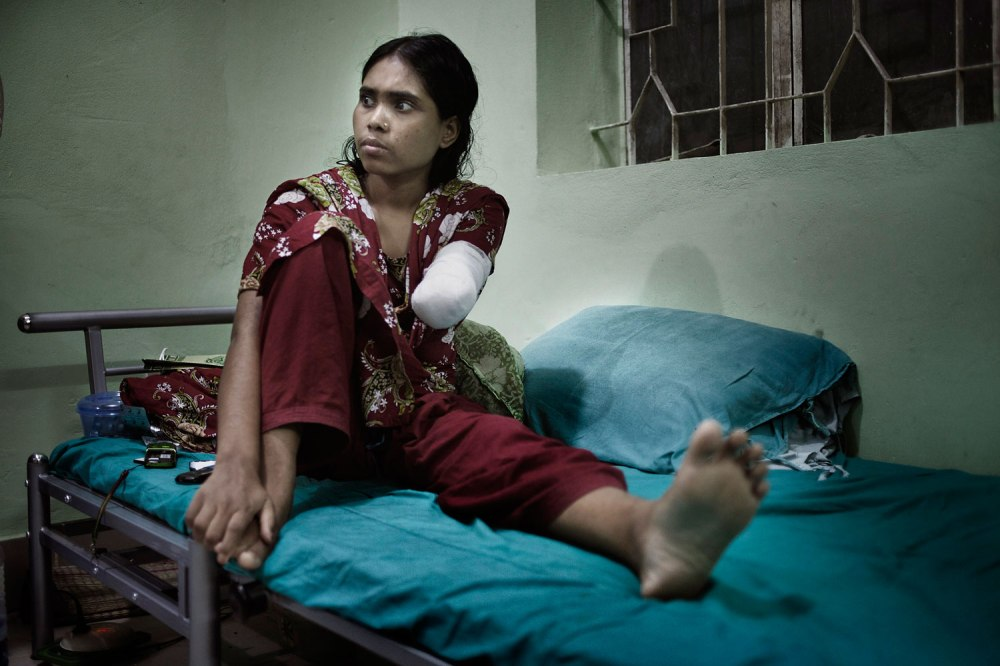 Rojina, 25, had to amputate part of her arm to escape the rubble of Rana Plaza.