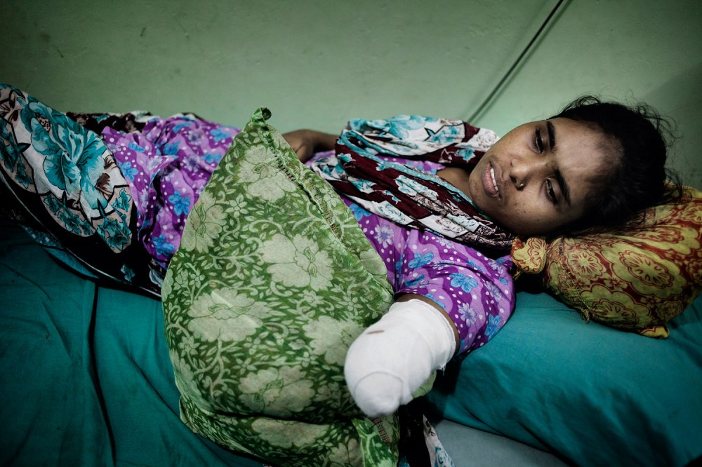 Rojina, 25, lost her hand in the Rana Plaza collapse. She worked there with her sister, Morjina, who is still listed as missing.