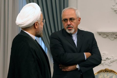 From left: Iranian President Hassan Rowhani talks to Mohammad-Javad Zarif at the presidential office in Tehran, on Aug. 4, 2013.