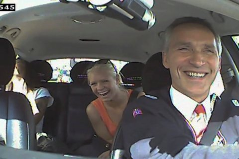 Norwegian Prime Minister Jens Stoltenberg drives a taxi in Oslo, in June 2013.