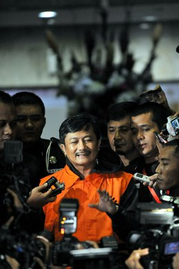Rudi Rubiandini appears in front of journalists after intensive examination by Corruption Eradication Commission after being arrested on suspicion of bribery in Jakarta, Indonesia, Aug. 14, 2013.