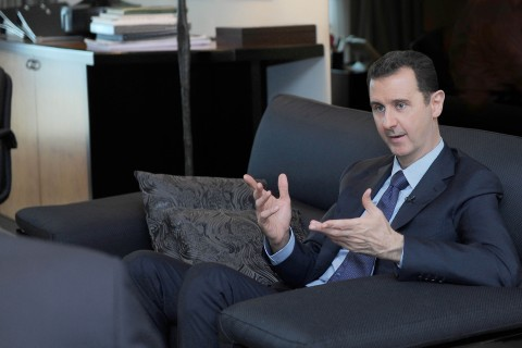 Syrian President Bashar al-Assad receives an interview with Russian newspaper Izvestia in Damascus, on Aug. 26, 2013.