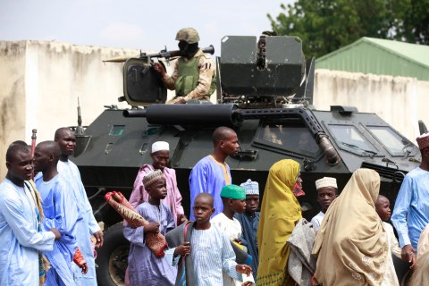 Nigerian soldiers in an armored personal carrier during Eid al-Fitr prayers at Ramat square in Maiduguri, Nigeria, on Aug. 8, 2013.