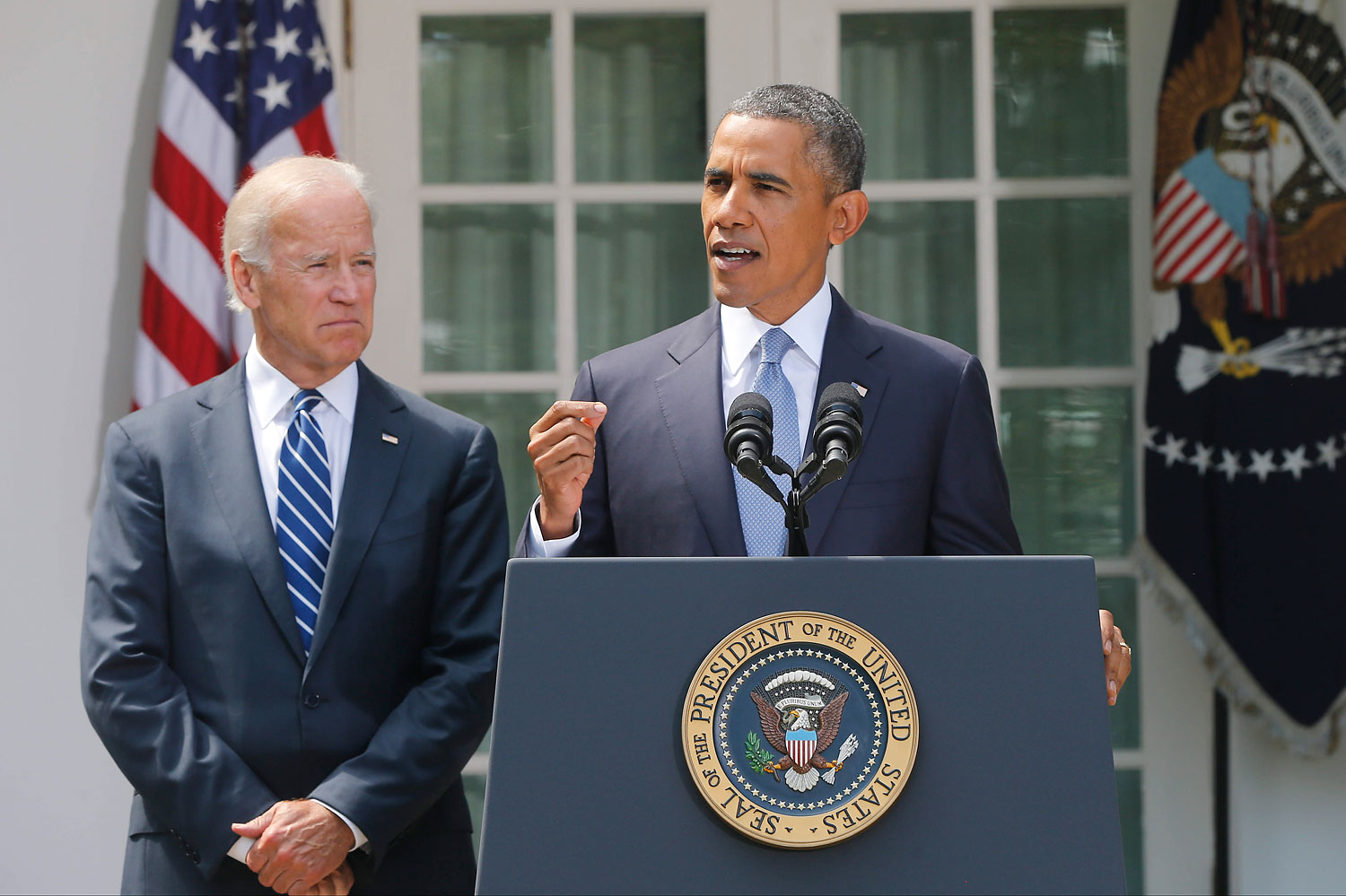 President Barack Obama stands with Vice President Joe Biden as he makes a statement about Syria in the Rose Garden at the White House in Washington Aug. 31, 2013.