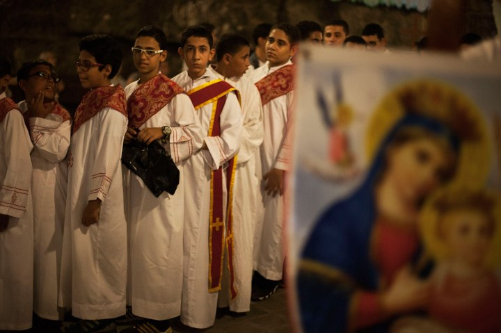 Egyptian youths line up before a procession at Al-Mahraq monastery in Assiut, Upper Egypt, Aug. 6, 2013.