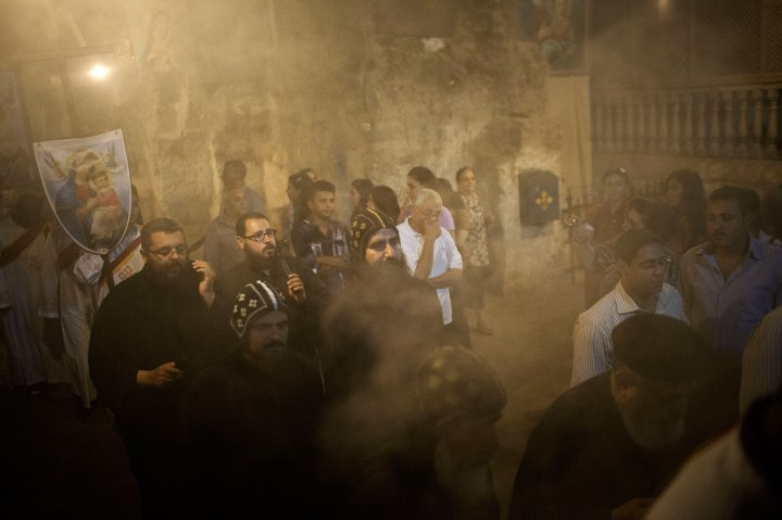 Coptics Priests and Monks purify with incense the holy cave during a procession within Al-Mahraq monastery in Assiut, Upper Egypt, Aug. 6, 2013.