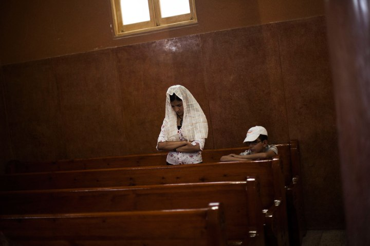 An Egyptian Coptic woman prays in a church within Al-Mahraq Monastery in Assiut, Upper Egypt, Aug. 6, 2013.