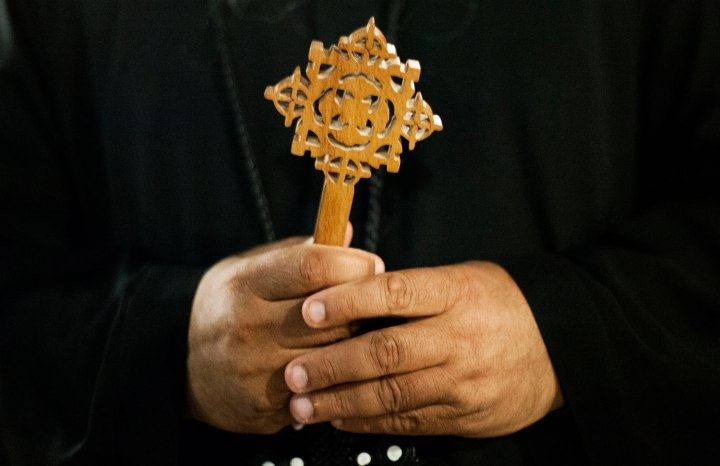 A Coptic Christian monk holds a Coptic cross at Al-Mahraq monastery during the preparation of a religious festival in Assiut, Upper Egypt, Aug. 6, 2013.