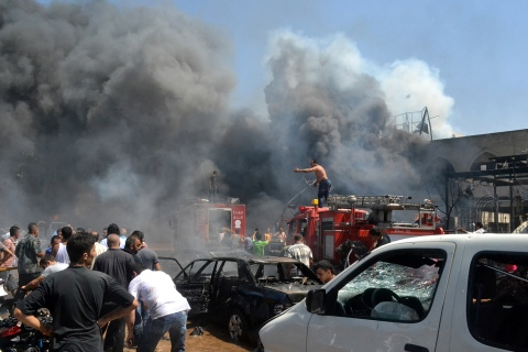 Lebanese citizens gather at the site of an explosion outside of a mosque in the northern city of Tripoli, Lebanon, on Aug. 23, 2013.
