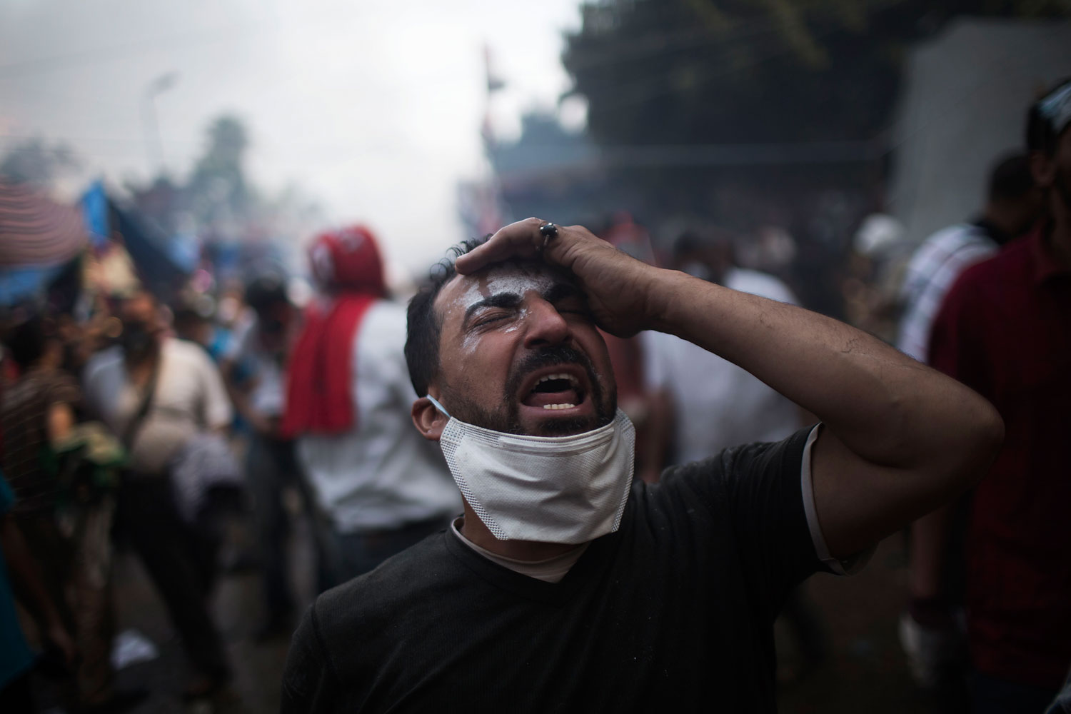 A supporter of ousted Egyptian President Mohammed Morsi reacts during clashes with Egyptian security forces in Rabaah Al-Adawiya in Cairo's Nasr City district, Aug. 14, 2013.