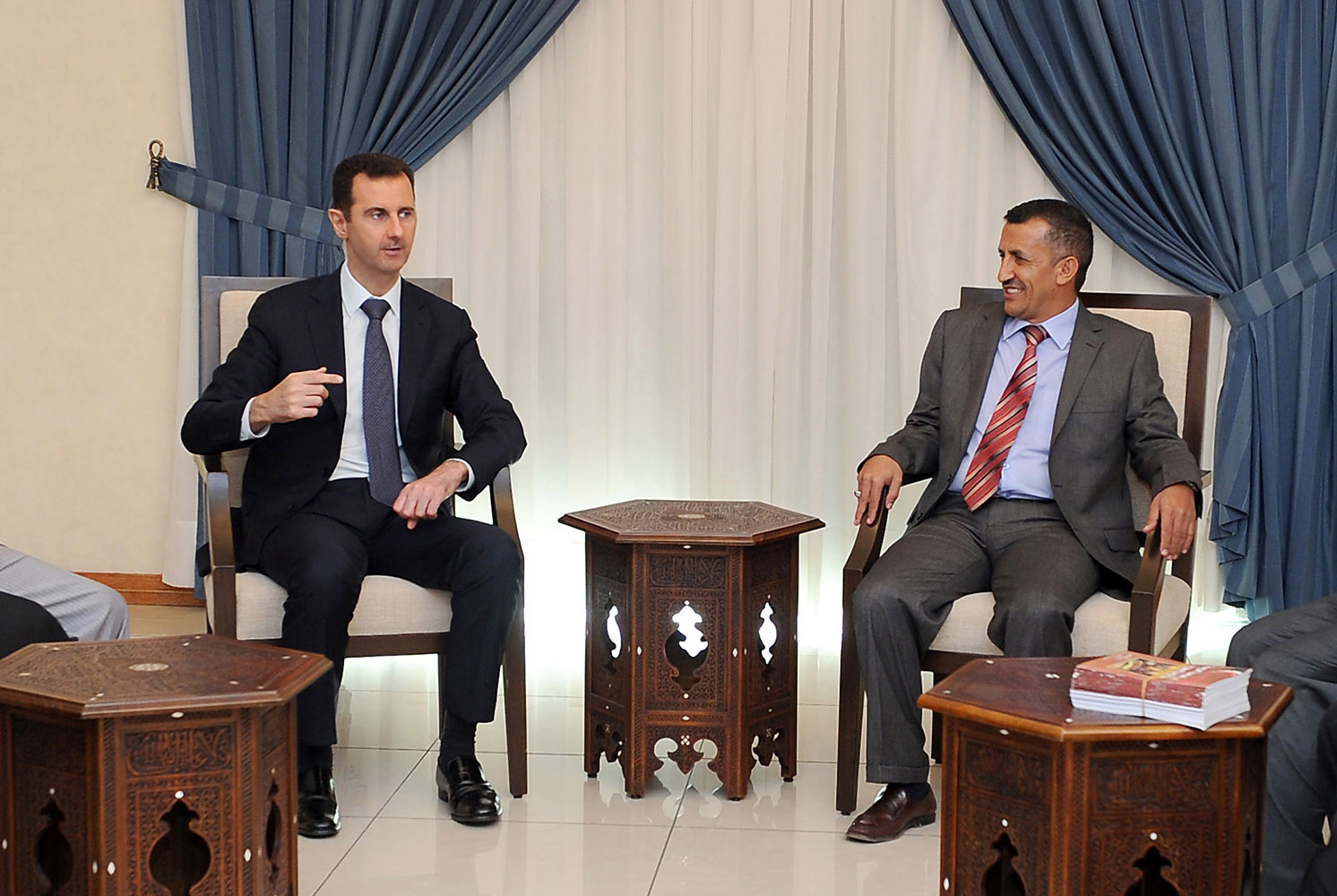A handout picture released by the Syrian Arab News Agencyon August 29, 2013 shows Syrian President Bashar al-Assad meeting with a Yemeni delegation of politicians in Damascus.
