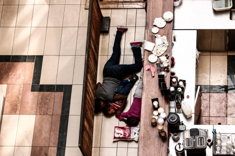 People take cover behind a counter at the Westgate shopping mall after a shootout in Nairobi, Kenya, Sept. 21, 2013.