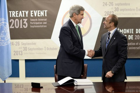 Secretary of State John Kerry shakes hands with Miguel de Serpa Soares of Portugal as Under-Secretary-General for Legal Affairs and United Nations Legal Counsel after signing the U.N. Arms Trade Treaty during the 68th Session of the United Nations General Assembly United Nations headquarters in New York City, Sept. 25, 2013.