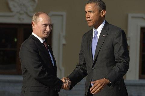 Russian President Vladimir Putin welcomes U.S. President Barack Obama at the start of the G20 summit on September 5, 2013 in Saint Petersburg.
