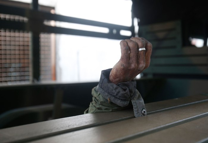 The hand of a dead Muslim rebel from the Moro National Liberation Front, killed by the government during fighting, is pictured in a military truck in Zamboanga city, Sep. 15, 2013.