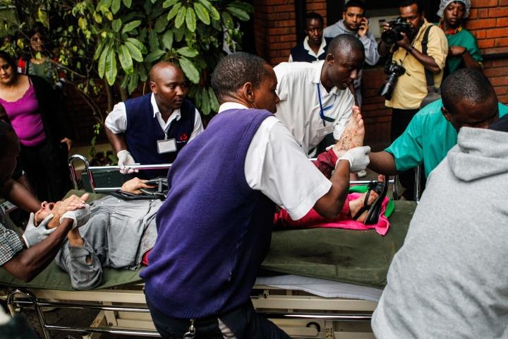 A wounded man arrives at the Aga Khan Hospital in Nairobi, Kenya, Sept. 21, 2013.