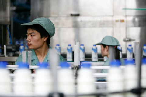 A worker mans a bottling line at one of Hangzhou Wahaha Group Co.'s bottling plants in Hangzhou, China, July 3, 2007.