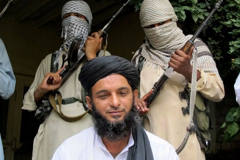 Asmatullah Muawiya, head of the Taliban's faction of fighters from central Punjab province, listens to reporters at an undisclosed place in Pakistani tribal region of Waziristan, Aug. 15, 2013.