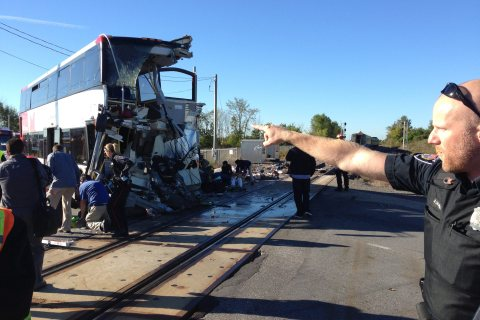 APTOPIX Canada Train Bus Collide