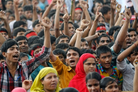 Garment workers shout slogans during a rally demanding an increase to their minimum wage in Dhaka
