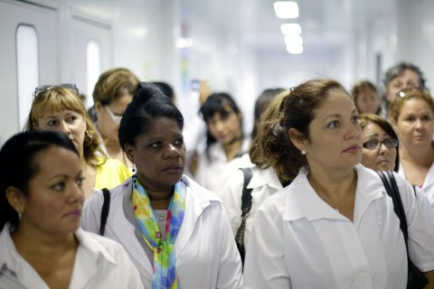 A group of Cuban doctors attend a training session at a health clinic in Brasilia, Brazil, Aug. 30, 2013.