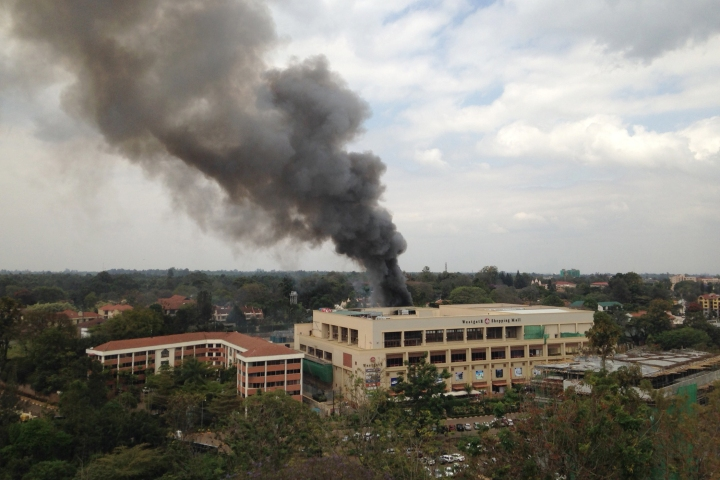 Heavy smoke rises from the Westgate Mall in Nairobi, Kenya Monday Sept. 23 2013. Multiple large blasts have rocked the mall where a hostage siege is in its third day.