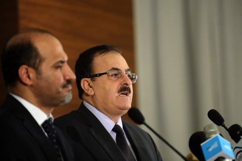 From right: Syrian rebel leader General Salim Idris and Syria's new opposition chief Ahmad Jarba hold a press conference in Istanbul, on Aug. 24, 2013.