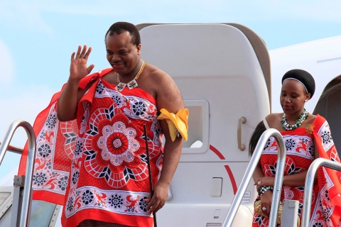 King of Swaziland Mswati iii and his wife disembark a plane after arriving at Katunayake International airport in Colombo
