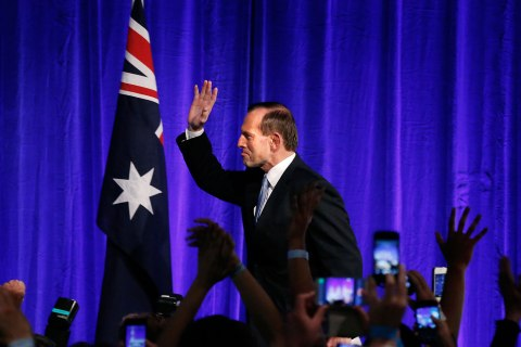 Australia's conservative leader Tony Abbott  gestures as he walks to the stage to claim victory in Australia's federal election during an election night function in Sydney Sept. 7, 2013.