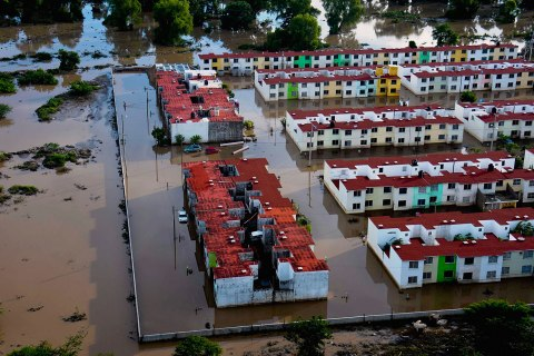 An aerial view of a flooded neighbourhood is seen in Acapulco