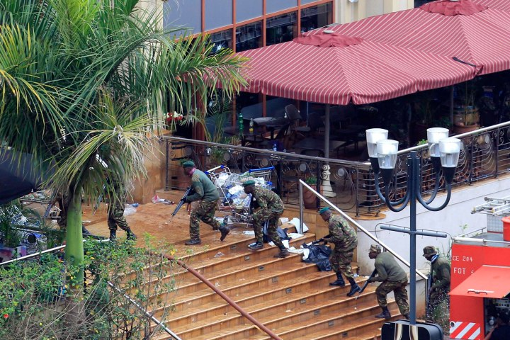 Kenya Defence Forces soldiers take their position at the Westgate shopping centre, on the fourth day since militants stormed into the mall, in Nairobi, Sept. 24, 2013.