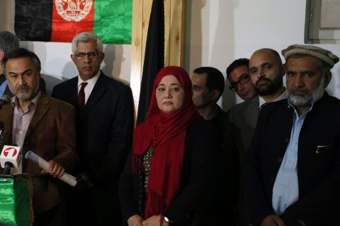 Afghan candidates who were disqualified by the Independent Election Commission (IEC) for running in the Presidential elections, talk to journalists during a press conference in Kabul, on Oct. 24, 2013.