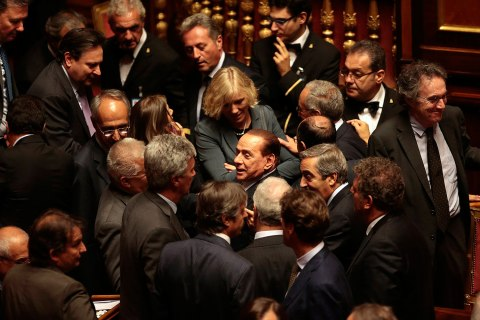 Italian center-right leader Berlusconi leaves during confidence vote at Senate in Rome