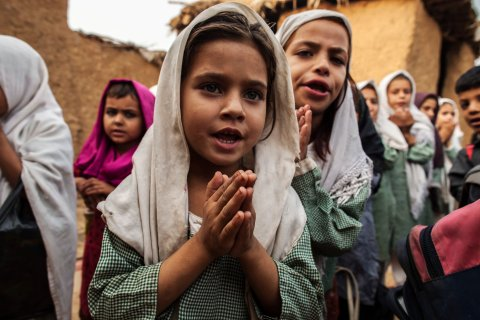 Girls pray before starting classes at a school in Islamabad, on Oct. 11, 2013.