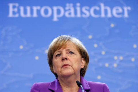 Germany's Chancellor Angela Merkel addresses a news conference during a European Union leaders summit in Brussels, on Oct. 25, 2013.