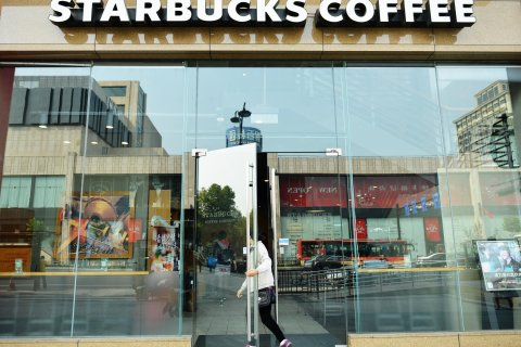 A customer enters a Starbucks Coffee in Hangzhou, China, on Oct. 21, 2013.