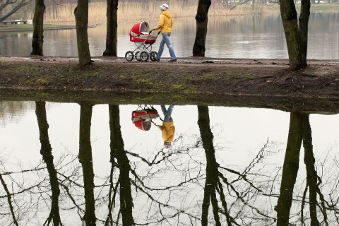 A Russian woman pushes a baby carriage