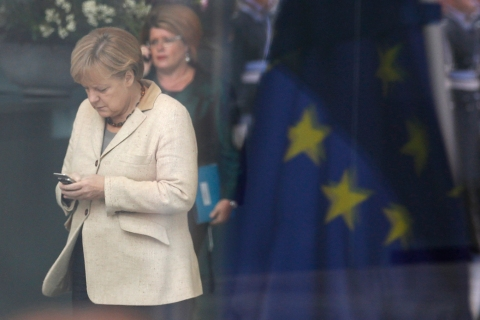 German Chancellor Merkel uses phone in Berlin