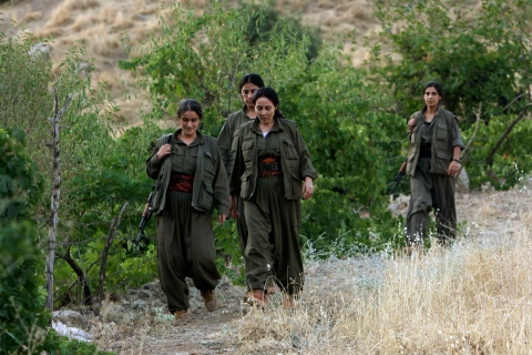 Female fighters from a PKK camp walk during a news conference  in the remote Qandil mountains near the Iraq-Turkish border in Sulaimaniya