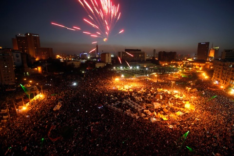 Protesters opposing Egyptian President Mohamed Mursi set off fireworks during a protest at Tahrir Square in Cairo