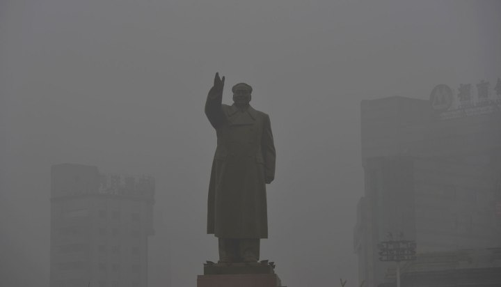 A statue of China's late Chairman Mao Zedong is pictured on a smoggy day in Shenyang
