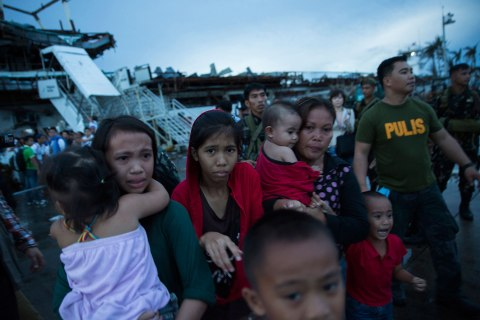 Survivors of Typhoon Haiyan react after not being allowed to board an evacuation flight from Tacloban Airport in Tacloban, Philippines, November 12, 2013.