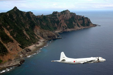 Japan Maritime Self-Defense Force's PC3 surveillance plane flies around the disputed islands in the East China Sea, known as the Senkaku isles in Japan and Diaoyu in China, October 13, 2011.