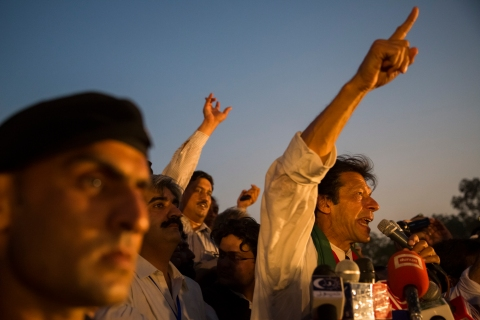 Imran Khan, chairman of the Pakistan Tehrik e Insaf (PTI) party, addresses supporters during an election campaign rally on May 05, 2013 in Faisalabad, Pakistan.