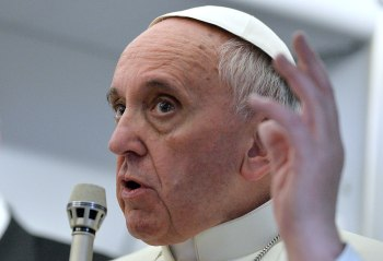 Pope Francis adresses to journalists aboard the papal flight, on the way back to Italy from Brazil, on July 28, 2013.