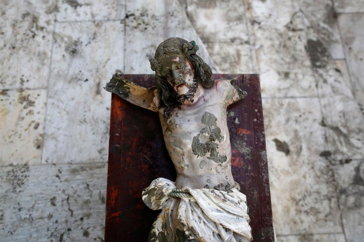 A damaged statue of Jesus Christ that was recovered from rubbles is placed in a church in an area wrecked by Typhoon Haiyan in Tacloban