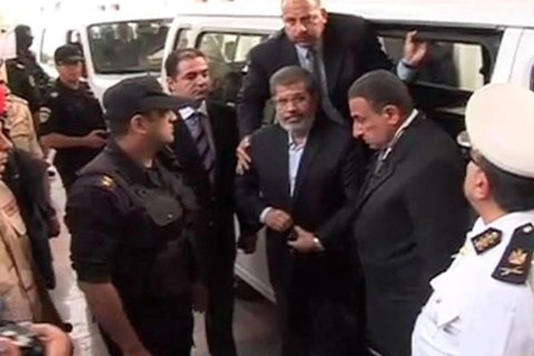 Video still shows ousted former Egyptian President Mursi getting out of a van as he arrives on the first day of his trial, at a courthouse in Cairo