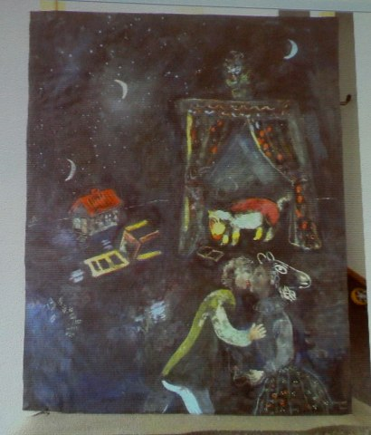 A formerly unknown painting of French artist Chagall is beamed to a wall at an Augsburg courtroom