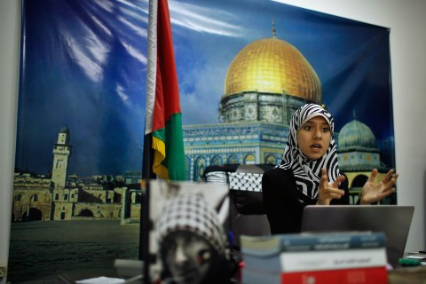 Isra Al-Modallal, a spokeswoman of the Hamas government in Gaza, talks to the foreign media at her office in Gaza City
