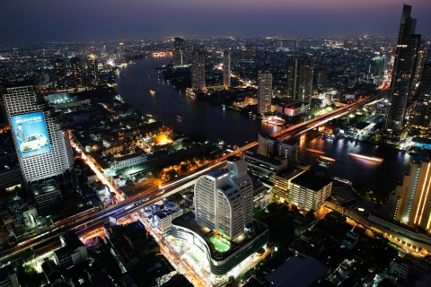 Cars and trains move on Taksin bridge over Chao Phraya river in central Bangkok